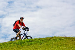 Cyclist riding on the mountain bike Royalty Free Stock Photos