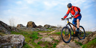 Cyclist Riding Mountain Bike on the Beautiful Spring Rocky Trail. Extreme Sport Concept Stock Images