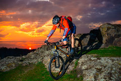 Free Cyclist Riding Mountain Bike Down Spring Rocky Hill At Beautiful Sunset. Extreme Sports And Adventure Concept. Royalty Free Stock Photography - 90002557