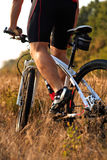 Cyclist riding mountain bike on rocky trail Stock Photo