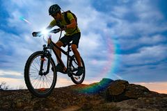 Cyclist Riding the Mountain Bike on Rocky Trail at Sunset. Extreme Sport and Enduro Biking Concept. stock images