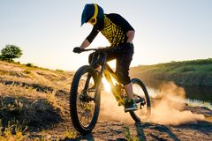 Cyclist Riding the Mountain Bike on the Summer Rocky Trail at the Evening. Extreme Sport and Enduro Cycling Concept. Stock Image