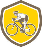 Cyclist Riding Mountain Shield Retro Stock Photography