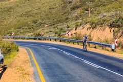 A cyclist riding on the R46 road. Royalty Free Stock Image