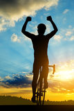 Cyclist riding a road bike Stock Photos