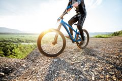 Cyclist riding on the rocky mountains stock photos