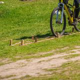 Cyclist riding on track. Closeup of male cyclist riding on green grass track Stock Photography