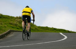 Cyclist riding uphill Stock Photo