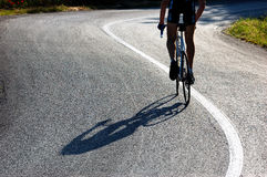 Cyclist riding uphill stock image