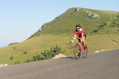 Cyclist on road bike Stock Photos