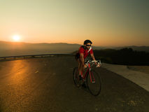 Cyclist on road bike Stock Images