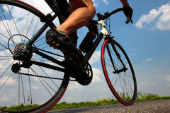 Cyclist on the road. Close-up view on a cyclist on the road stock image