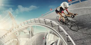 Cyclist. Road like the roller coaster. royalty free stock photography