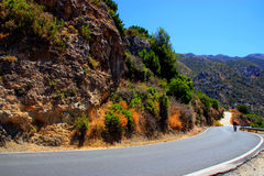 Cyclist on road. Into the mountains Stock Photos