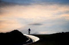 Cyclist on a road Stock Image