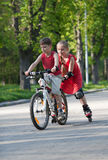 Cyclist and rollerblader Royalty Free Stock Photo