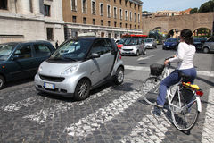 Cyclist in Rome Stock Image