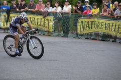 Cyclist Rounds Tight Turn at Uptown Criterium Royalty Free Stock Images