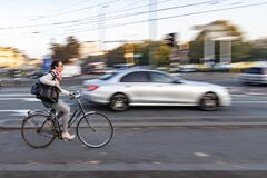 Free Cyclist Rushing Out To Work In The Morning Stock Image - 174049101