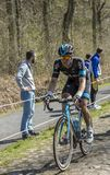 The Cyclist Salvatore Puccio in The Forest of Arenberg- Paris Ro. Trouee d`Arenberg,France - April 12,2015: The Italian cyclist Salvatore Puccio of Team Sky Stock Photography