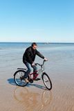 Cyclist at sea. Stock Photos