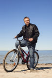 Cyclist at sea. Stock Photography