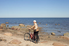 Cyclist at sea. Royalty Free Stock Images