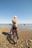 Cyclist at sea. Stock Image