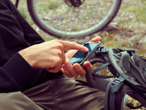 Cyclist searches GPS coordinates Royalty Free Stock Images