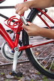 Cyclist Securing Bike With Lock Stock Photography