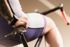 Cyclist. Selective focus of cyclist leaning on bicycle saddle stock photo