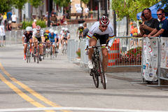 Cyclist Separates Himself From Pack In Criterium Event Stock Photography