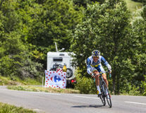 The Cyclist Sergey Lagutin. Chorges, France- July 17, 2013: The Uzbek cyclist Sergey Lagutin from  Vacansoleil-DCM Team pedaling during the stage 17 of 100th Royalty Free Stock Images