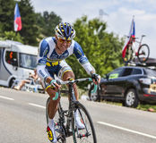 The Cyclist Sergey Lagutin. Chorges, France- July 17, 2013: The Uzbek cyclist Sergey Lagutin from  Vacansoleil-DCM Team pedaling during the stage 17 of 100th Royalty Free Stock Photo