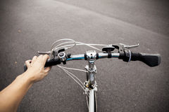 Cyclist setting out to commute on his bicycle in the parking a l Stock Images