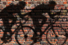 Cyclist shadow on wall Royalty Free Stock Photo