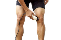 Cyclist shaving his legs Royalty Free Stock Photography