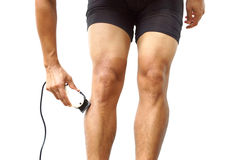 Cyclist shaving his legs Stock Images