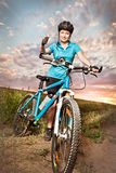 Cyclist showing thumb up. Pretty young woman on the bike showing thumb up Royalty Free Stock Photography