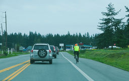 Cyclist on side of the road Royalty Free Stock Image