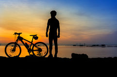 Cyclist silhouette sunrise Stock Image