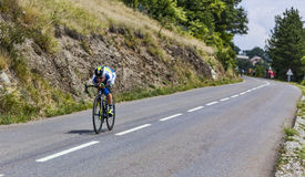 The Cyclist Simon Clarke. Chorges, France- July 17, 2013: The Italian cyclist Australian Clarke from Orica-GreenEDGE Team pedaling during the stage 17 of 100th Royalty Free Stock Photography