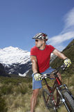 Cyclist Sitting On Bike In Field Stock Images