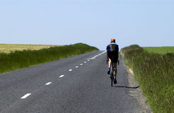 Cyclist on a small road Stock Photo