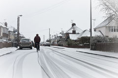 Cyclist in the snow Stock Photo