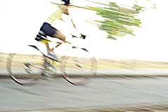 Cyclist speed blurs Stock Images