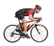 Cyclist sprints on a bike Stock Images
