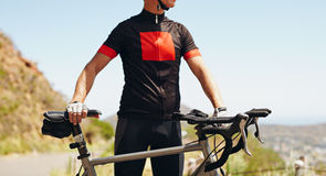 Cyclist standing with his bike - Outdoors Stock Photo