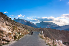 Cyclist standing on mountains road. Himalayas. Picture taken during bicycling trip in autumn. Himalayas, India Royalty Free Stock Photography