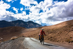Cyclist standing on mountains road. Himalayas Royalty Free Stock Photo